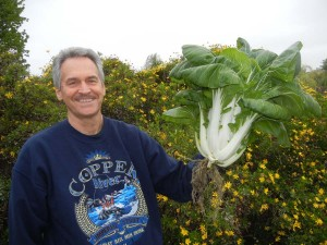 Colle Davis, Inventor, Portable Farms, holding a 20.5 pound head of Bok Choy grown in 45 days.
