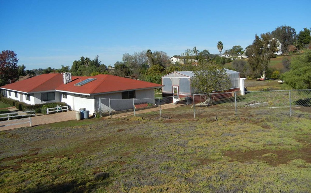 Note the farm sitting in the back of our house in Southern California. We had two acres on our property but chose to install it close the house near the kitchen for care of the farm and for easy harvesting. This small 16'x33' farm was large enough to feed ten people FOREVER.