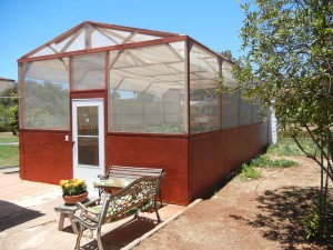 This 16' x 33' greenhouse contains 3 modules of Portable Farms® Aquaponics Systems and feeds 10 people FOREVER.