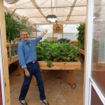Colle Davis, Lead Inventor, showing the interior of a 16' x 33' Portable Farms® Aquaponics System.