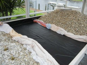 Repairing leak in Pond Liner in the Grow Tray. This should NOT have happened, but it did.