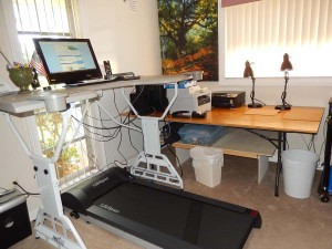 Phyllis Davis' new standing desk with treadmill underfoot.